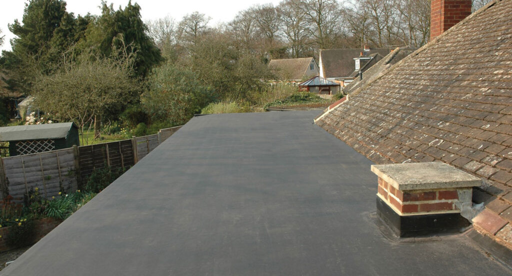 This is a photo of a flat roof covered using EPDM roofing material. This image is used to illustrate one of the choices I considered when selecting my roof cover material for my house build.