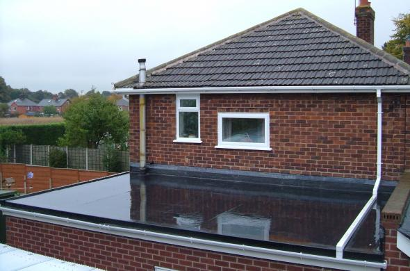 This is another photo of a flat roof covered using EPDM roofing material. This image is used to illustrate one of the choices I considered when selecting my roof cover material for my house build.