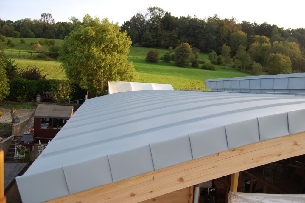 This image shows part of my finished curved roof using a traditional metal standing seam roof which I installed myself.